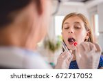 female pediatrician using a... | Shutterstock . vector #672717052