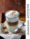 glass of latte coffee and brown ... | Shutterstock . vector #672721735