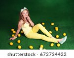 smiling girl with bright yellow ... | Shutterstock . vector #672734422