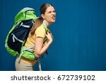 tired girl with heavy backpack... | Shutterstock . vector #672739102