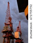 harbour cranes  jersey  u.k. ... | Shutterstock . vector #672755752