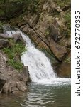 the zaskalnik waterfall in the... | Shutterstock . vector #672770335
