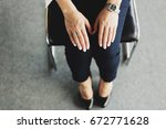 woman in pants is sitting on... | Shutterstock . vector #672771628