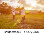 two child riding a bicycle. the ... | Shutterstock . vector #672792838