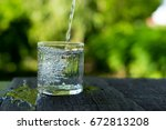 pour into a glass | Shutterstock . vector #672813208