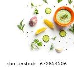 delicious yogurt sauce in bowl... | Shutterstock . vector #672854506