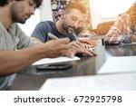 university students filling in... | Shutterstock . vector #672925798