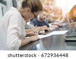 university students filling in... | Shutterstock . vector #672936448