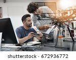engineer and technician working ... | Shutterstock . vector #672936772