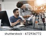 engineer and technician working ... | Shutterstock . vector #672936772