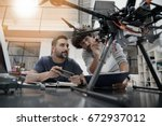 engineer and technician working ... | Shutterstock . vector #672937012