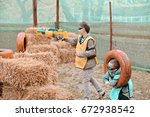 two young boys with blasters...   Shutterstock . vector #672938542