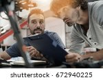 engineer and technician working ... | Shutterstock . vector #672940225