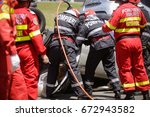 rescue firefighters and... | Shutterstock . vector #672943582