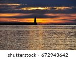 beautiful gold sunrise over the ... | Shutterstock . vector #672943642