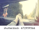 relaxed person with feet on... | Shutterstock . vector #672959566