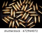 Small photo of 9 mm full metal jacket bullet on black background