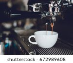 espresso shot from coffee... | Shutterstock . vector #672989608