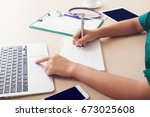 on the desks of busy clinicians.... | Shutterstock . vector #673025608