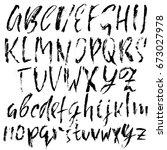 hand drawn dry brush font.... | Shutterstock .eps vector #673027978