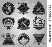 premium blacksmith emblems set... | Shutterstock .eps vector #673031062