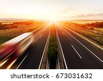 highway in a strong back light... | Shutterstock . vector #673031632