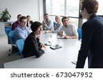 business team meeting in modern ... | Shutterstock . vector #673047952