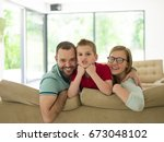 happy young family with little... | Shutterstock . vector #673048102