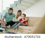 happy young family with little... | Shutterstock . vector #673051732