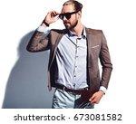portrait of handsome fashion... | Shutterstock . vector #673081582
