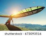 hang glider starting to fly | Shutterstock . vector #673093516