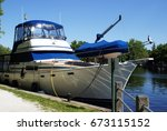 closeup of a boat docked at the ... | Shutterstock . vector #673115152
