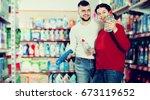happy couple buying detergents... | Shutterstock . vector #673119652
