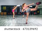 women in a boxing class... | Shutterstock . vector #673139692