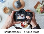 professional food photographer... | Shutterstock . vector #673154035