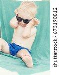 Blond Toddler Boy Wearing...