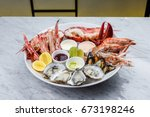 fresh seafood platter with... | Shutterstock . vector #673198246