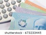 canadian dollar and calculator  ... | Shutterstock . vector #673233445