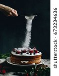 woman sifting icing sugar over... | Shutterstock . vector #673234636