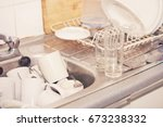washing up in office kitchen... | Shutterstock . vector #673238332