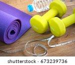 dumbbells yoga mat  bottle of... | Shutterstock . vector #673239736