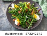 dandelion salad with eggs and... | Shutterstock . vector #673242142