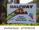 "Small photo of Haiku, Hawaii, USA – November 9, 2016: Maui ""Halfway to Hana"" advertisement sign along the Road to Hana promoting Banana Bread, Ice Cream, Refreshments and Shave Ice"