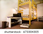Stock photo interior of the hostel bedroom hostel with wooden bunk beds 673304305