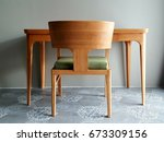 light on the wood table and the ... | Shutterstock . vector #673309156