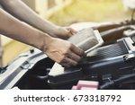 technician holding dirty air... | Shutterstock . vector #673318792