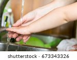 hands of a child under the... | Shutterstock . vector #673343326