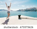 happy woman on vacation... | Shutterstock . vector #673373626