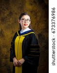 chinese girl in graduation... | Shutterstock . vector #673376986