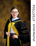 chinese girl in graduation... | Shutterstock . vector #673377016